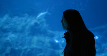 Woman In The Aquarium, And Loo...