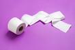 Leinwandbild Motiv Roll of toilet paper on color background