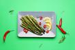 Leinwandbild Motiv Cooked asparagus with chili pepper and lemon on color background