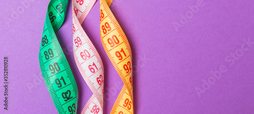 Close up of colorful measure tapes on purple background Canvas Print