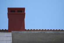 Red Chimney Of The Old Building