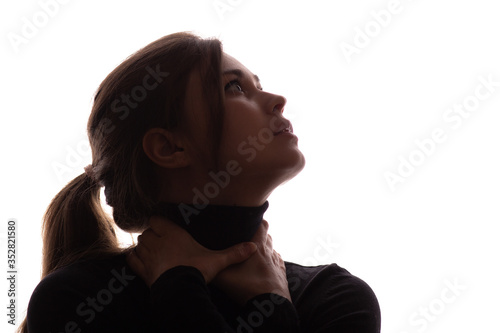 Valokuvatapetti portrait face of young beautiful woman in a black with hands clutching neck, lif