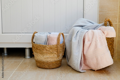Fototapeta Two wicker basket with pile of dirty laudry ready for cleaning. Bunch of sheets and towels prepared for washing. Close up, copy space, background. obraz