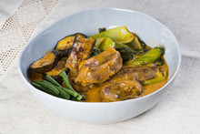 Kare Kare; A Mix Of Ox Tail And Tripe With Vegetables Like Eggplant, Sitaw (long Bean), Pechay, Puso Ng Saging Stewed In Peanut Sauce And Serve With Shrimp Paste For Additional Flavor