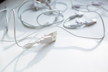 Usb And Other Wires On A White Background