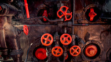 Toned Photo Of Old Rusty Steam Pipes And Red Valves On Steam Boiler Of Old Locomotive
