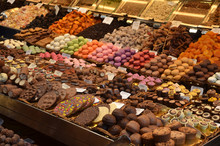 Sweet And Chocolate Stall In The Food Market In Barcelona, Spain, Mercado De La Boqueria.