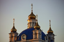 Beautiful Golden Domes With Crosses Close Up On Chtistianity Church Blue Roof On Sunny Sunset, Symbol Of Faith