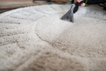 Housekeeper Arm Cleaning Carpet With Washing Vacuum Cleaner