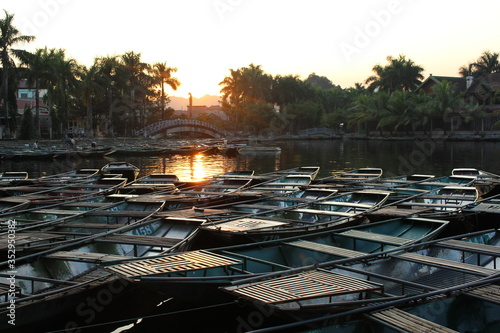 Photo Couché de soleil sur les barques