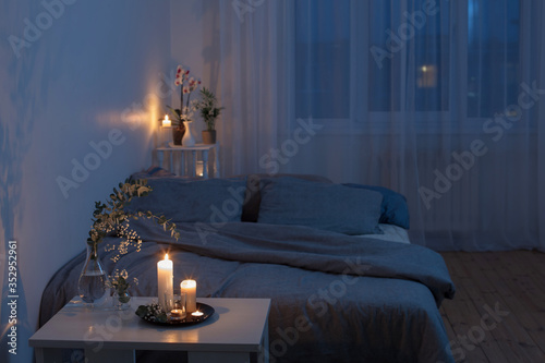 Fototapeta night interior of bedroom with flowers and burning candles obraz
