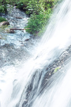 A Close Up View Of Cascading W...