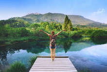 Woman On A Lake