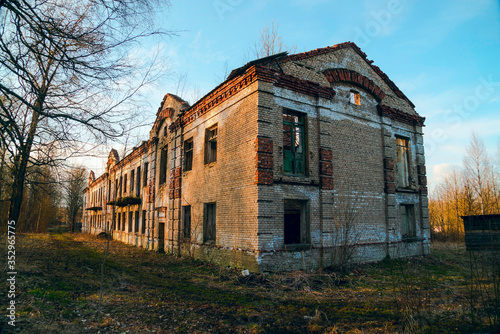An old abandoned two-story brick building Canvas Print