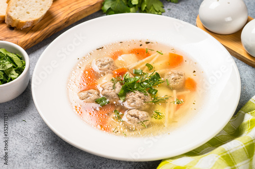 Fototapeta Meatballs soup with vegetables top view. obraz