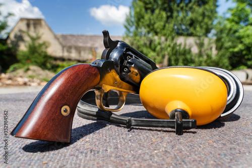 Fotografie, Obraz Old black powder Percussion Army Revolver vintage gun replica Civil War Old wild