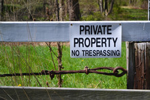 Sign On Wooden Fence Stating '...