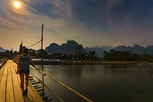 Tourist Walks On Bamboo Bridge...
