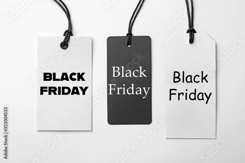 Fototapety, obrazy: Different tags with text BLACK FRIDAY on white background, flat lay