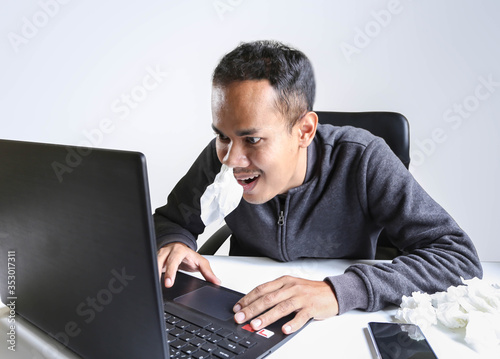 The young man aroused and excited sex addict man watching porn mobile online in laptop computer addiction and internet pornographic content concept Canvas Print