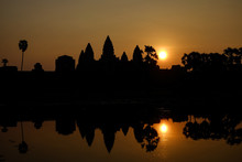 Beautiful View Of The Silhouette Angkor Wat And Its Reflection In The Lake At Sunrise