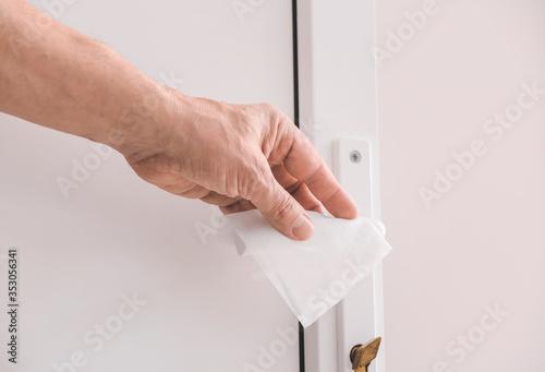 Obraz Man disinfecting door handle, closeup - fototapety do salonu