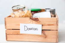 Box With Donations On Table Ag...