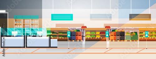 Obraz empty no people supermarket during coronavirus pandemic quarantine concept covid-19 epidemic modern grocery shop interior horizontal vector illustration - fototapety do salonu