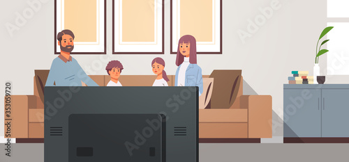 Obraz family watching TV daily news program parents with children sitting on couch modern living room interior horizontal vector illustration - fototapety do salonu
