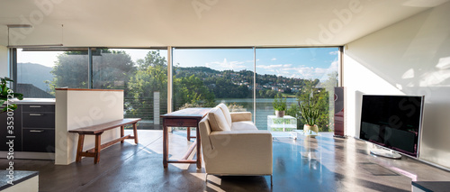 Fototapeta Modern lounge with a beautiful view of a pond. We are in Switzerland obraz