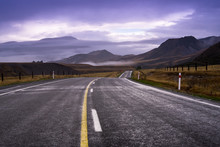 The Long Local Road Across Yellow And Green Grass Field Goto Mountain That Have Cloud On Behind Like A Heaven