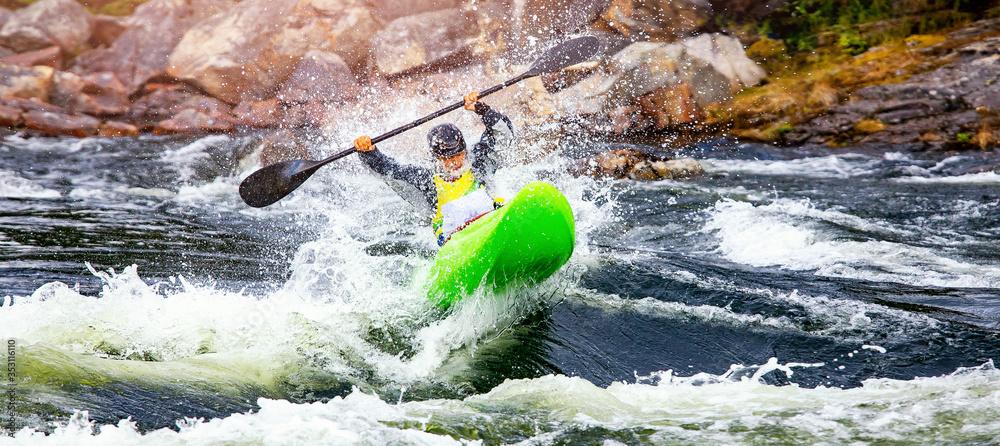 Fototapeta Banner whitewater kayaking, extreme sport rafting. Guy in kayak sails mountain river