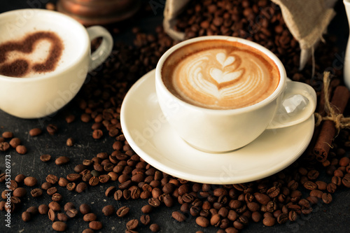 Fototapety, obrazy: Latte art on a tide of coffee beans