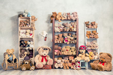 Retro Teddy Bear Plush Toys Great Collection On Wooden Shelving, Antique Rocking Chair, Old Stool, Boxes Front Loft Concrete Wall Background. Childhood Nostalgia Concept. Vintage Style Filtered Photo