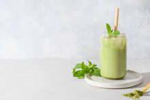 Iced Green Matcha Tea In Glass Garnish Mint Isolated On White Table. Space For Text. Close Up. Horizontal Orientation.