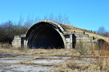 An Old Airfield With Abandoned Aircraft Hangar Military Landscape