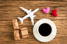 Coffee And Airplane Models And Hearts And Baggage, Planning A Holiday Trip For Couples.
