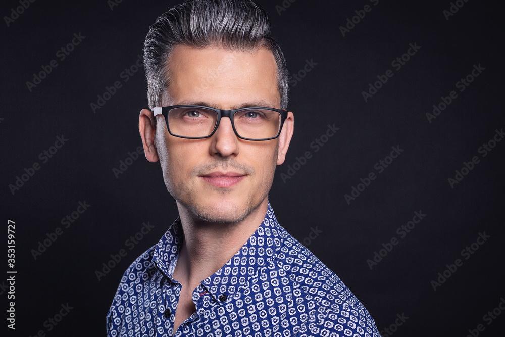 Fototapeta A headshot portrait of a man in mid 30, early 40