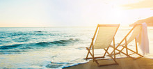 Background With Couple Of Deck Chairs At Sunset, Travel Concept, Summer Background