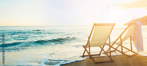 Valokuvatapetti Background with couple of deck chairs at sunset, Travel concept, Summer backgrou