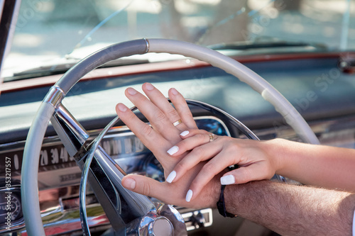 Fotomural Bride and groom exchanging wedding rings close up during symbolic nautical decor
