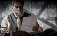 Colonial Man Reading A Document During The 1776 War