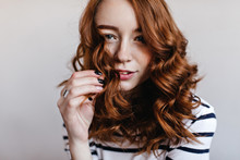 Close-up Portrait Of Blithesome Woman With Black Manicure Wears Elegant Silver Ring. Indoor Shot Of Charming Ginger Girl Isolated On Light Background.