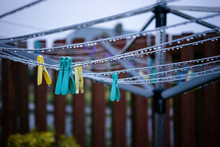 Clothes Pegs On A Wet Clothes Line