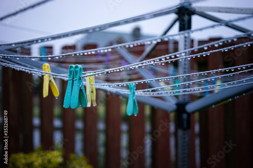 Obraz na plátne Clothes pegs on a wet clothes line
