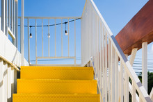Yellow Metal Stairs With White...