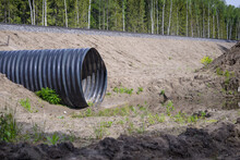 New Corrugated Metal Drainage Culvert Pipe Installed In Ditch Under The Road