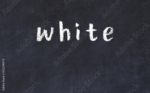 College chalk desk with the word white written on in Canvas Print