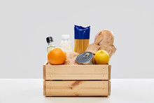 Eating, Grocery And Delivery Concept - Food In Wooden Box On Table Over Grey Background