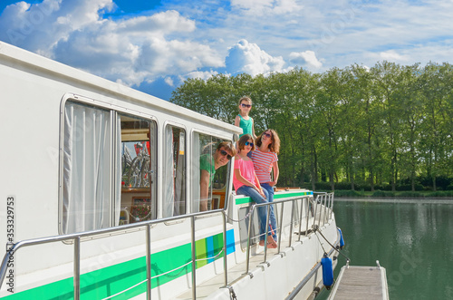 Family vacation, travel on barge boat in canal, happy parents with kids having f Fotobehang